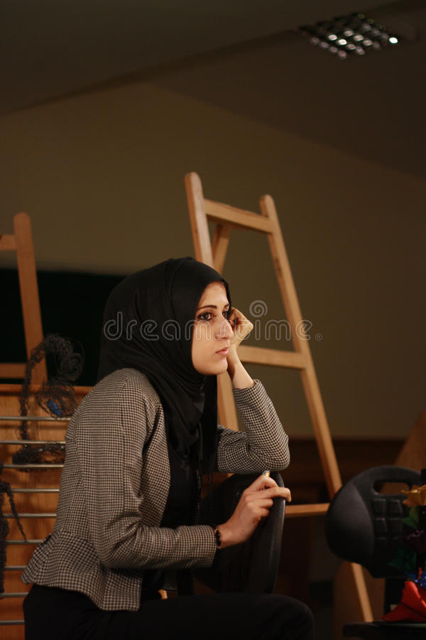 Portrait of a beautiful arab girl in veil posing royalty free stock photography