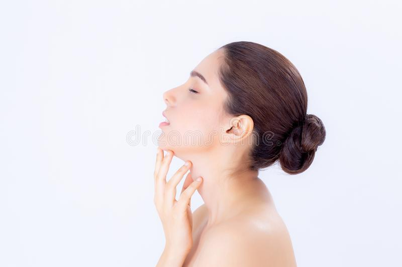 Portrait of beautiful asian brunette woman makeup of cosmetic, girl hand touch chin and smile attractive stock photo