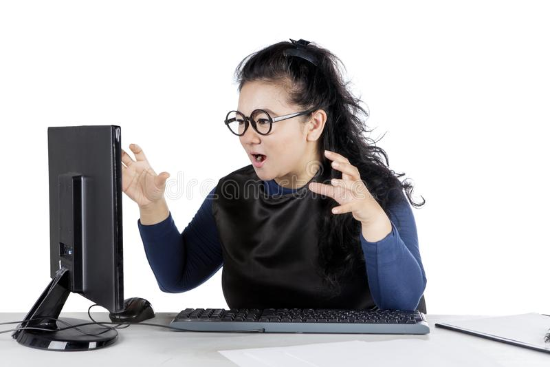 Beautiful businesswoman annoyed at her desktop stock photos