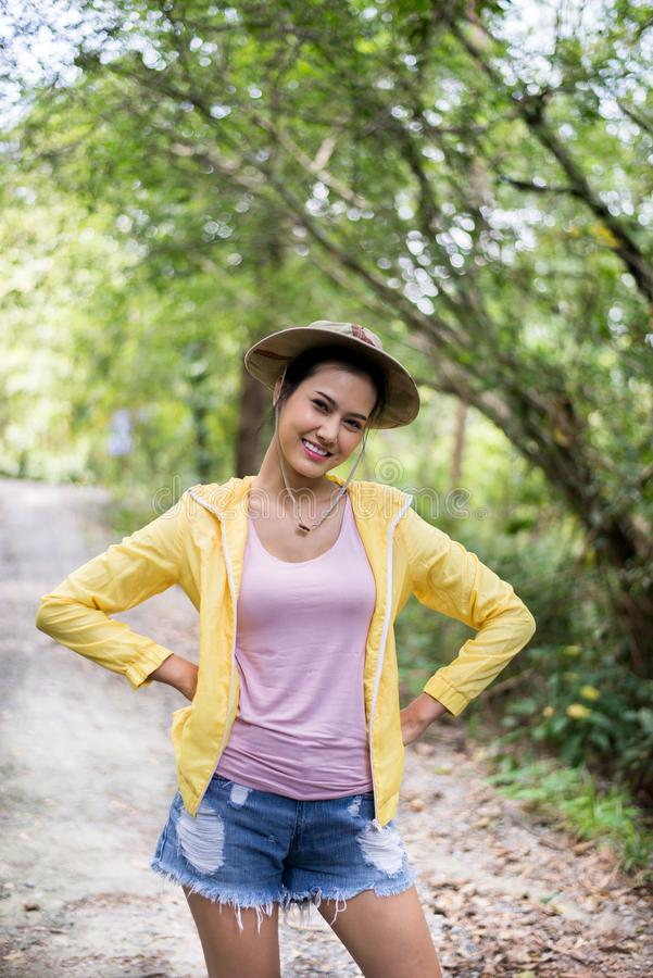 Portrait of beautiful asian girl happy and smiling while standing at forest,Travel at outdoor stock photo