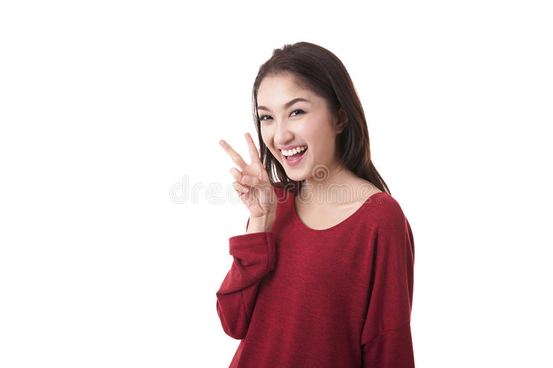 Portrait beautiful asian girl show v-sign on white background royalty free stock images
