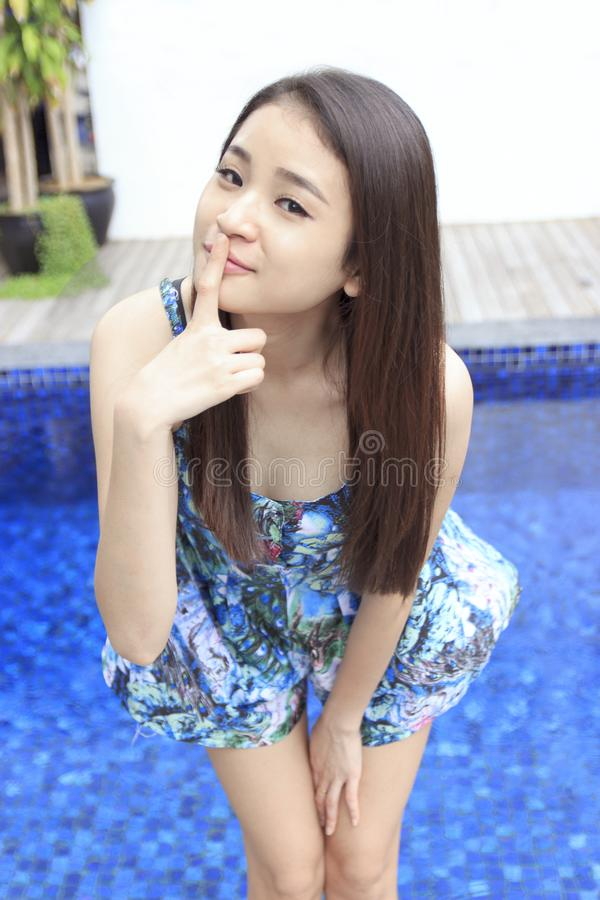 Portrait of a beautiful asian girl at the swimming pool stock photography