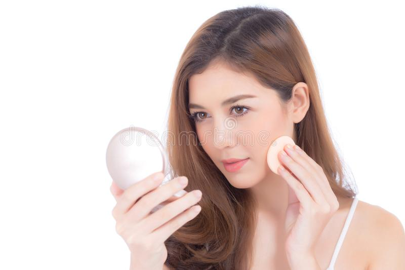 Portrait of beautiful asian woman applying powder puff at cheek makeup of cosmetic, beauty of girl with face smile isolated stock photo