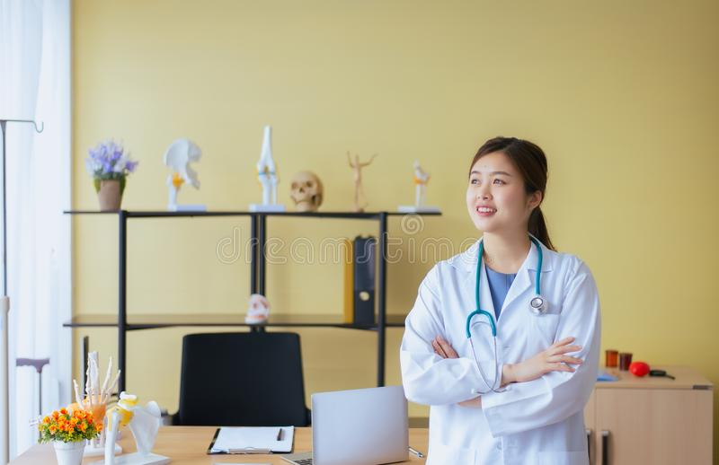 Portrait of beautiful asian woman doctor cross arm and standing at hospital,Happy and positive attitude thinking stock image