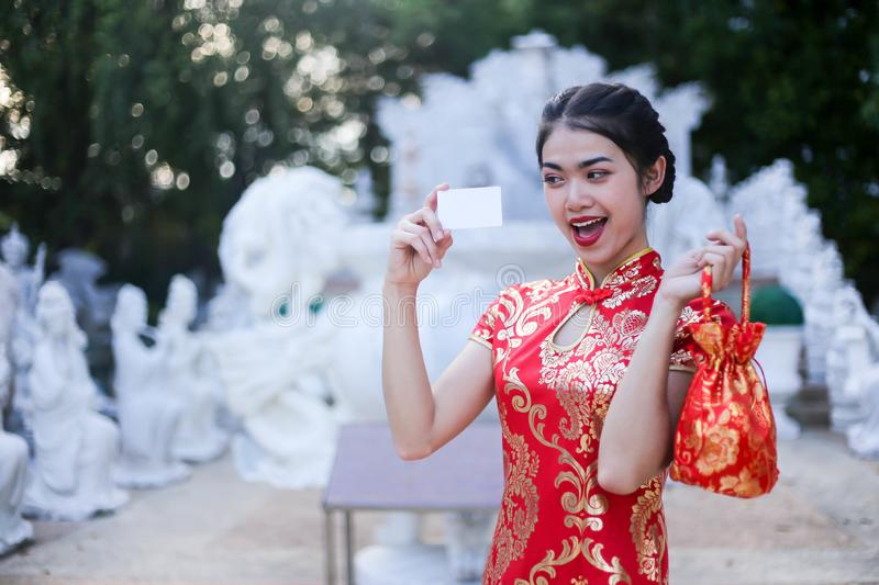 Portrait of a beautiful Asian Woman hold with luck money and red pocket,chinese new year concept royalty free stock photos