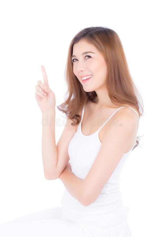 Portrait of beautiful asian woman makeup of cosmetic, beauty of girl with face smile and finger point something attractive isolate stock photography