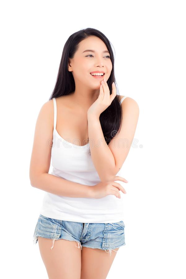 Portrait of beautiful asian woman makeup of cosmetic, girl hand touch cheek and smile attractive stock photo