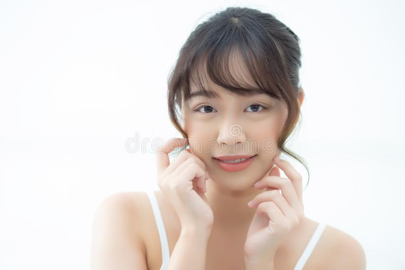 Portrait beautiful asian woman makeup of cosmetic, girl hand touch cheek and smile attractive, face beauty perfect with wellness royalty free stock photo
