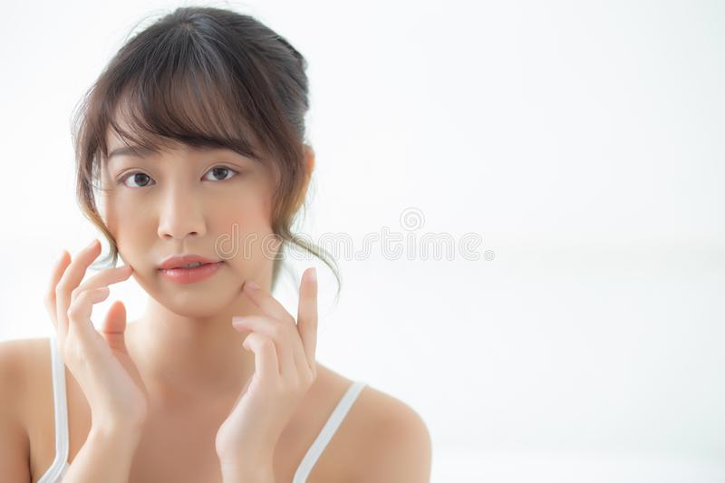Portrait beautiful asian woman makeup of cosmetic, girl hand touch cheek and smile attractive. Face beauty perfect with wellness in the bedroom at home with royalty free stock images