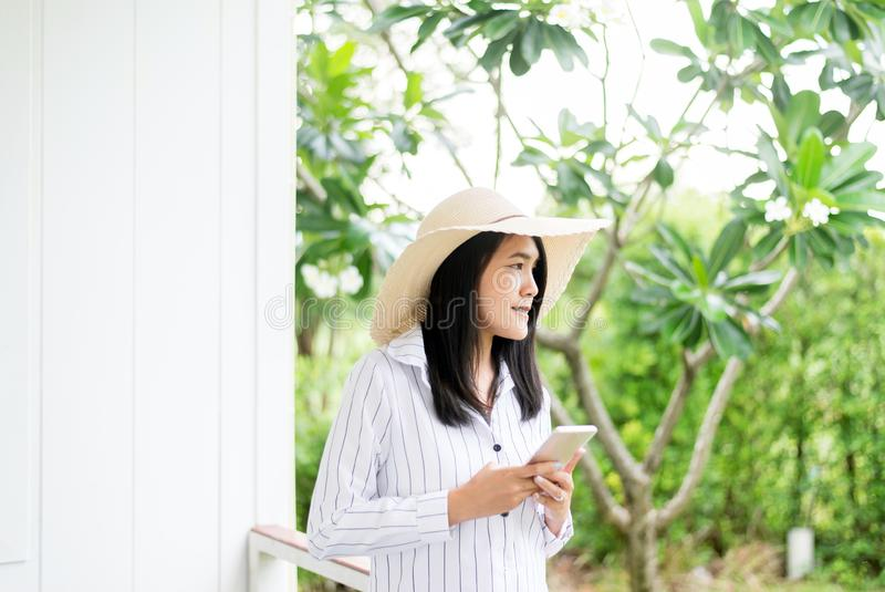 Portrait of beautiful asian woman using mobile phone and smiling at outdoor,Positive thinking,Good attitude royalty free stock photos