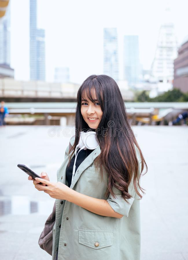 Portrait beautiful asian woman using mobilephone and walking in the city,Female confidence happy and smiling,Lifestyle concept royalty free stock photos