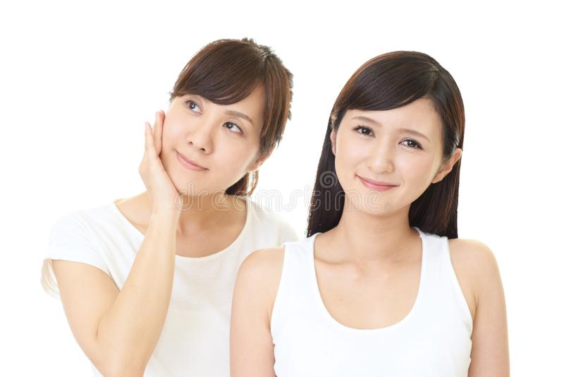 Smiling Asian women royalty free stock photos