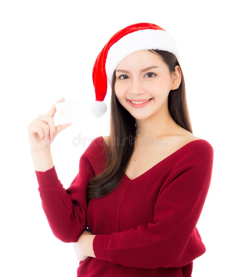Portrait of beautiful asian young woman in santa hat smile holding credit card. Girl have happy with shopping isolated on white background, christmas and stock image