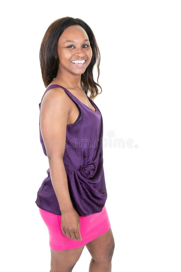 Portrait of beautiful attractive African American woman wearing pink purple clothes with happy smiling in white studio background stock photos