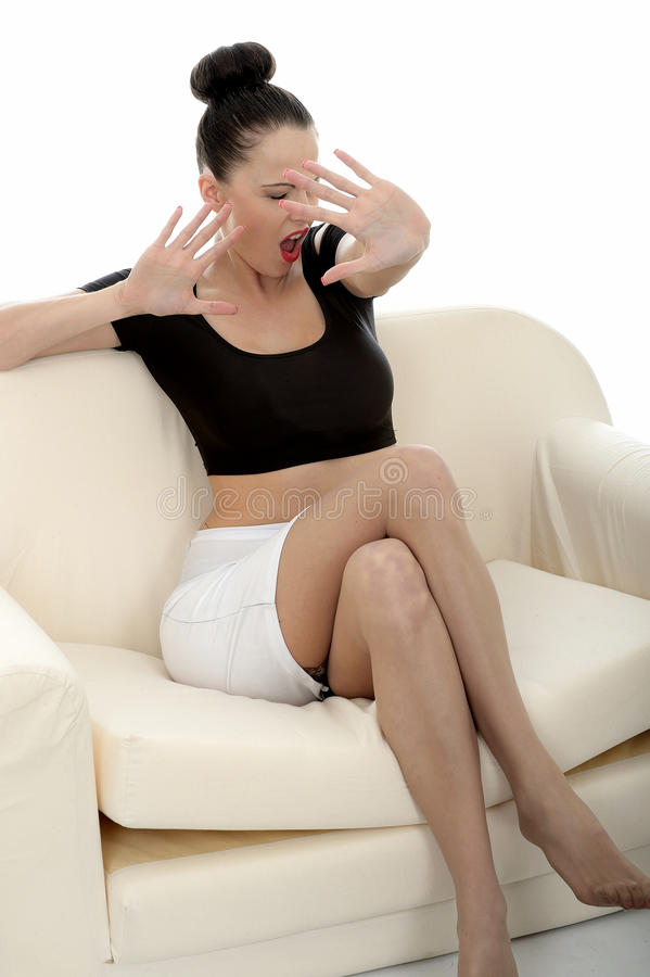 Portrait Of A Beautiful Attractive Young Caucasian Woman Relaxing And Posing On A Sofa Or Couch stock image