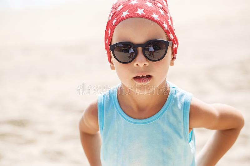 Portrait of a beautiful baby boy in sunglasses. In Thailand royalty free stock photo