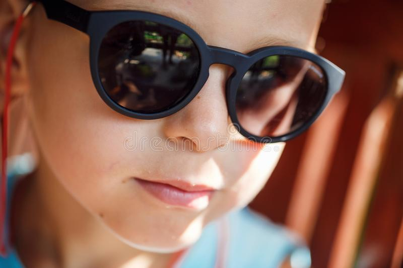 Portrait of a beautiful baby boy in sunglasses. In Thailand stock photo