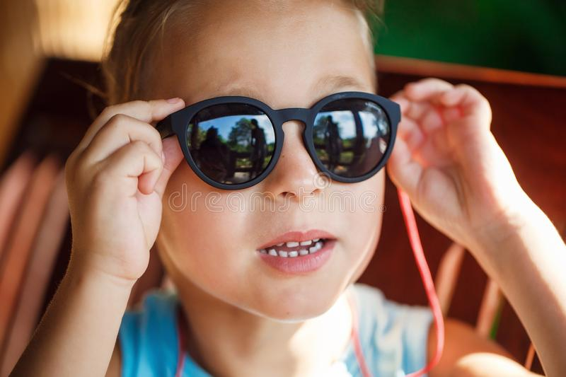 Portrait of a beautiful baby boy in sunglasses. In Thailand royalty free stock image