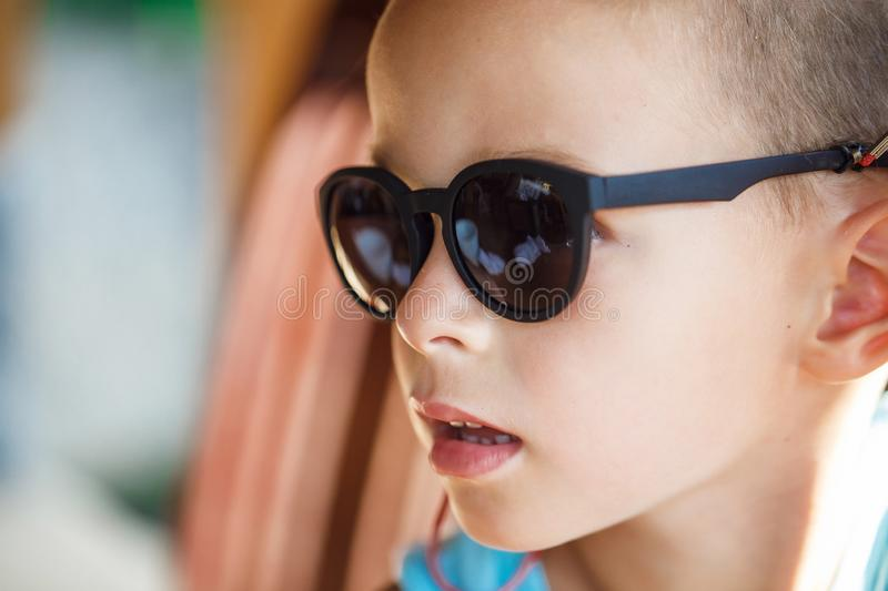 Portrait of a beautiful baby boy in sunglasses. In Thailand royalty free stock photography
