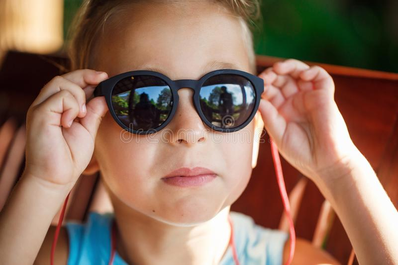 Portrait of a beautiful baby boy in sunglasses. In Thailand royalty free stock images