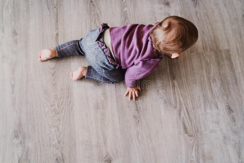 portrait of beautiful baby girl crawling at home royalty free stock photo