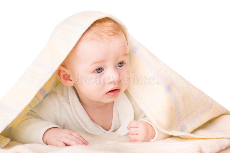 Portrait of a beautiful baby under a blanket stock photo