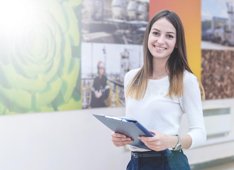 Portrait of a beautiful black-haired girl at the university stock photos
