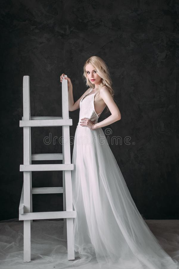 Portrait of a beautiful blond girl in image of the bride . Beauty face. Photo shot in the Studio on a grey background stock photos