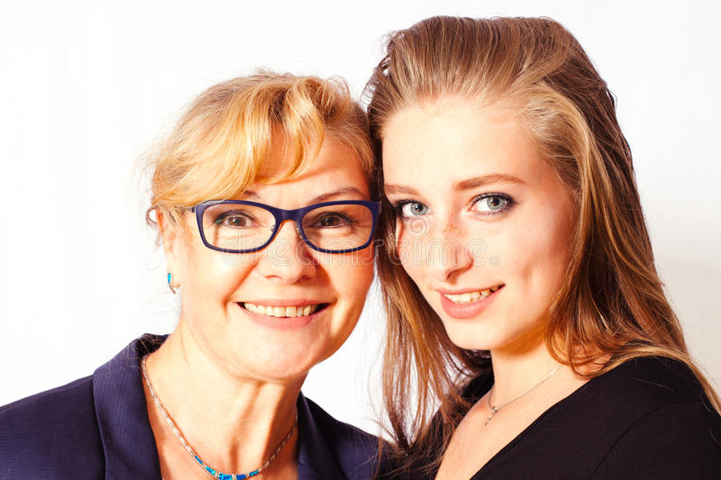 Portrait of beautiful blond girl with mother stock photo