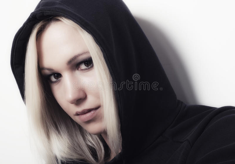 Portrait of the beautiful blond rapper girl.  royalty free stock photography