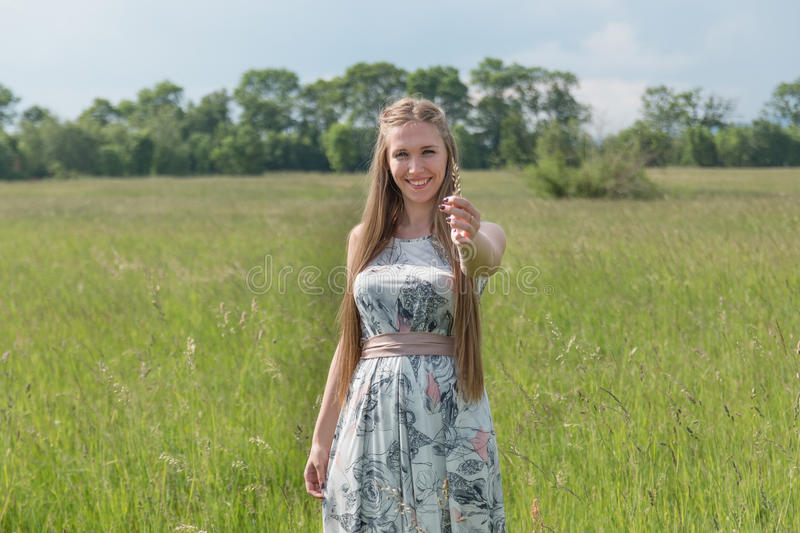 Portrait of beautiful blond woman in a field stock photos