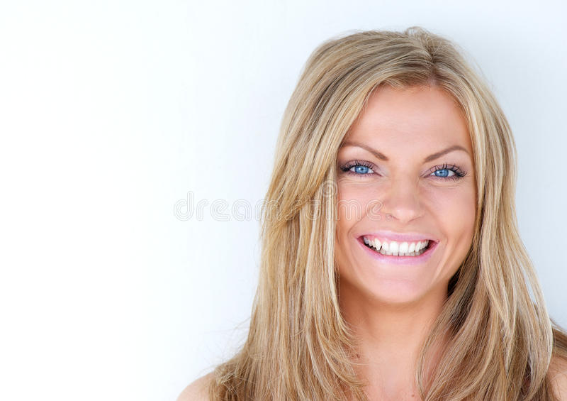 Portrait of a beautiful blond woman laughing royalty free stock photo