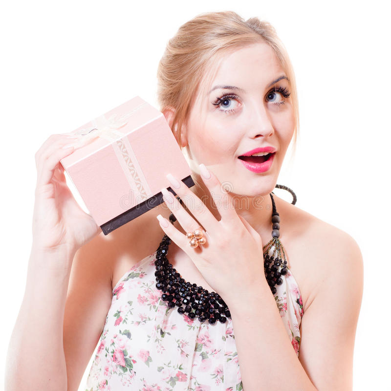 Portrait of beautiful blond young woman blue eyes female having fun listening to gift or present pink box happy smiling royalty free stock image