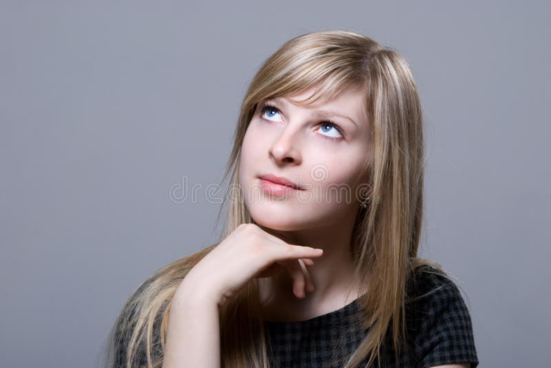 Portrait of the beautiful blonde. Looking off in thought - expression series - thinking stock image