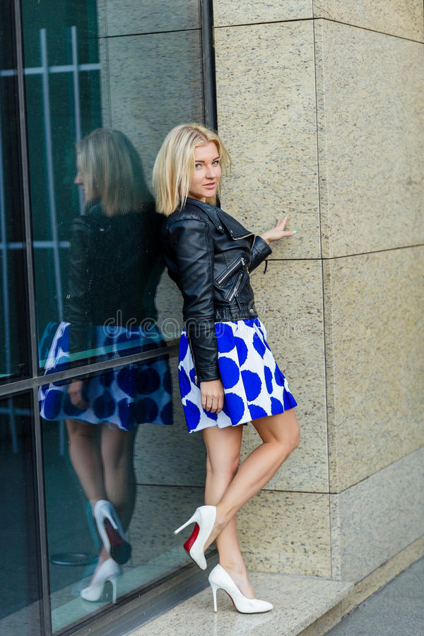 Download Portrait Of A Beautiful Blonde In Blue Skirt Stock Photo - Image: 83718731