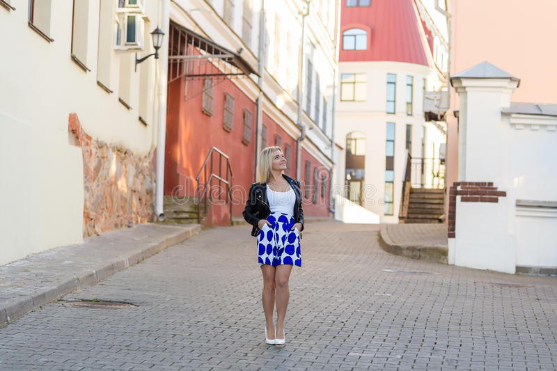 Download Portrait Of A Beautiful Blonde In Blue Skirt Stock Image - Image of business, contrast: 83719919