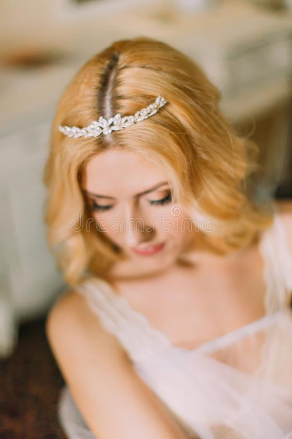 Portrait of beautiful blonde bride in diamond tiara close up royalty free stock images