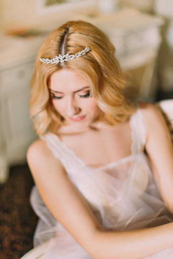 Portrait of beautiful blonde bride in diamond tiara close up stock photo