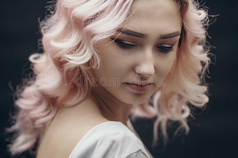Portrait of a beautiful blonde girl, face of a young woman with curly hair, cosplay, image of a peasant woman, fairy-tale mood stock photo