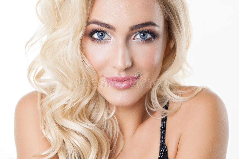 Portrait of beautiful blonde girl with healthy perfect clean skin, big blue eyes, long eyelashes. Natural look. Studio royalty free stock photo