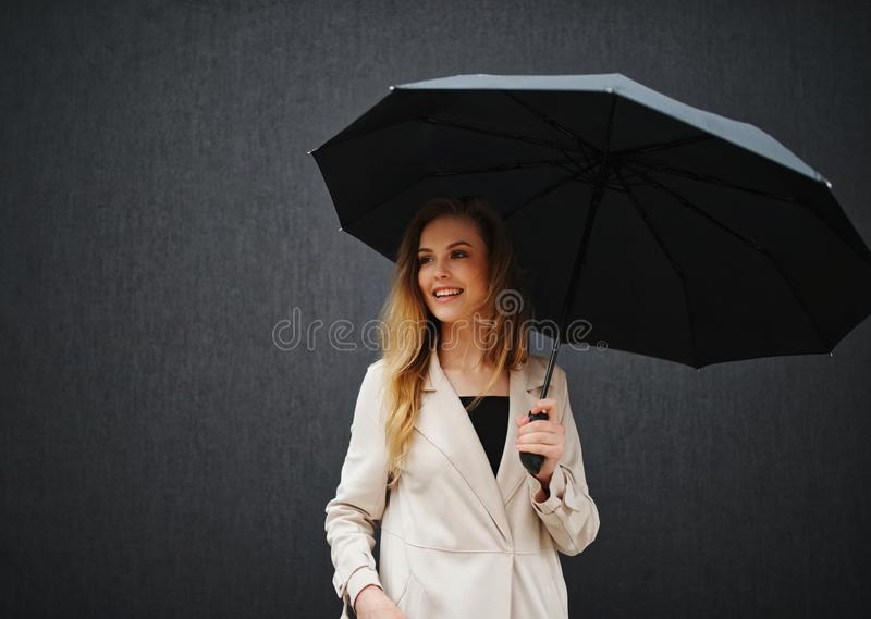 Beautiful blonde girl with umbrella royalty free stock photography