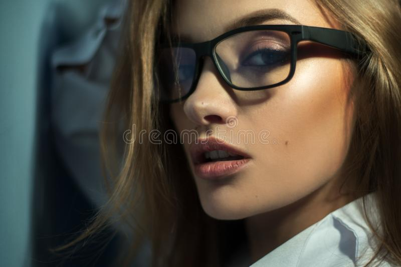 Portrait of beautiful blonde in glasses with make up and healthy skin looking at the camera royalty free stock photos