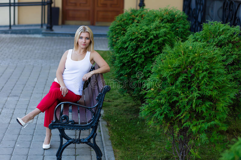 Download Portrait Of A Beautiful Blonde In Red Pants Stock Photo - Image: 83717574