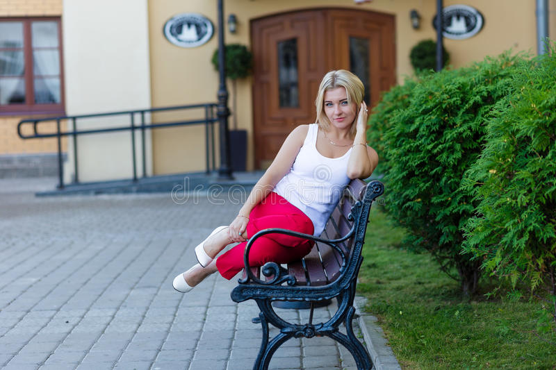 Download Portrait Of A Beautiful Blonde In Red Pants Stock Photo - Image: 83718149