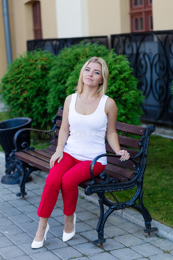 Download Portrait Of A Beautiful Blonde In Red Pants Stock Photo - Image: 83718687