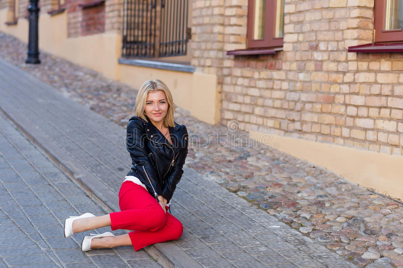 Download Portrait Of A Beautiful Blonde In Red Pants Stock Photo - Image: 83719218