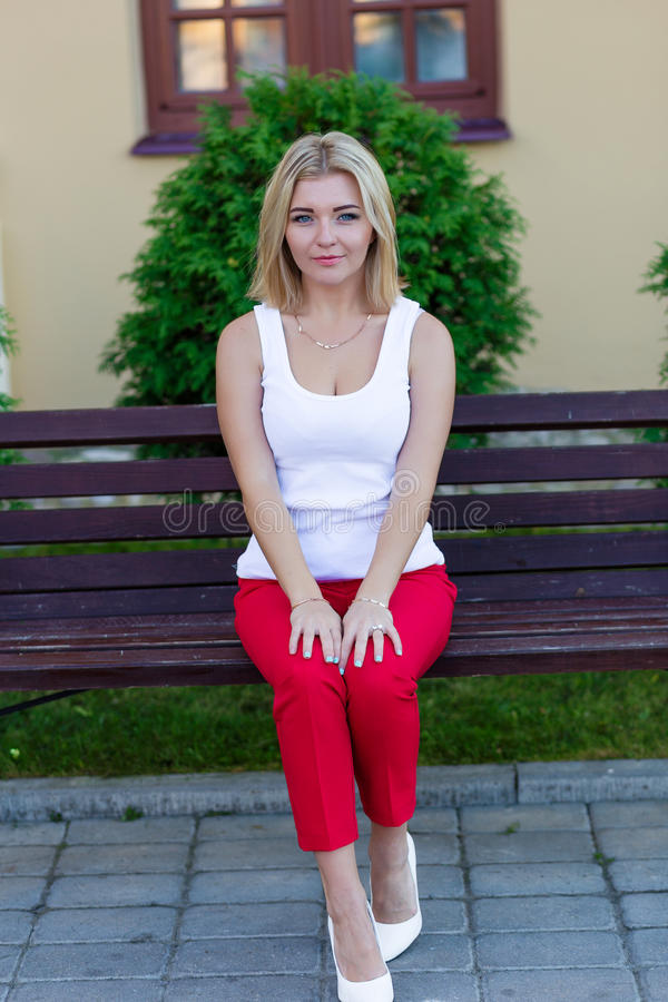Download Portrait Of A Beautiful Blonde In Red Pants Stock Photo - Image: 83719575