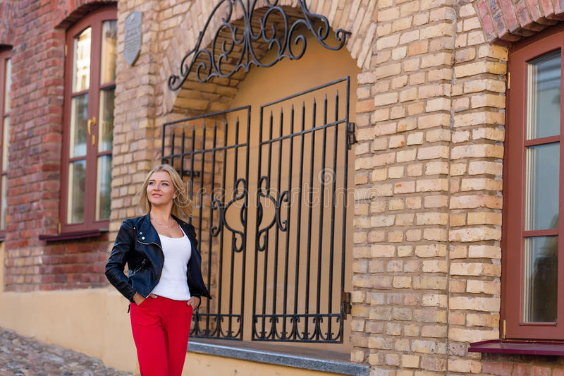Download Portrait Of A Beautiful Blonde In Red Pants Stock Photo - Image: 83719922