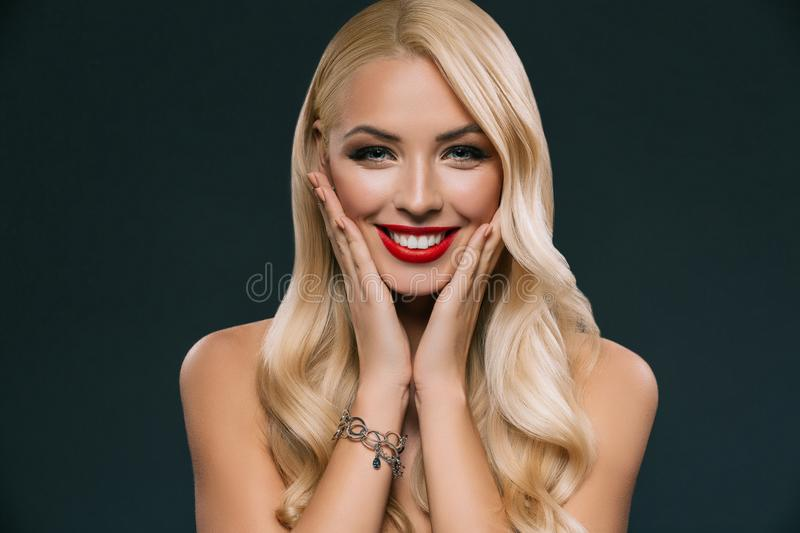 portrait of beautiful blonde smiling woman with makeup stock photo
