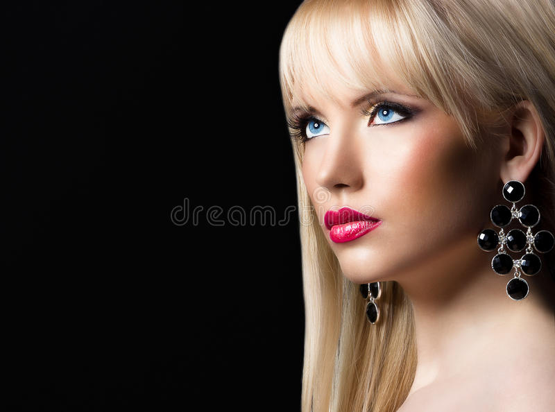 Portrait of young beautiful blonde woman with perfect makeup. Portrait of beautiful blonde woman with perfect makeup royalty free stock images